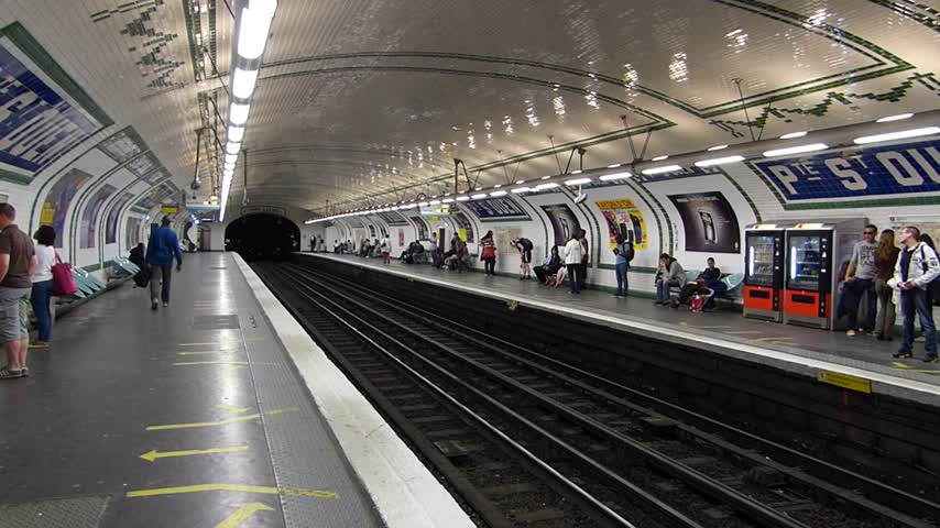 french metro : Metro in Paris, France time lapse. People wait and travel by train in subway.