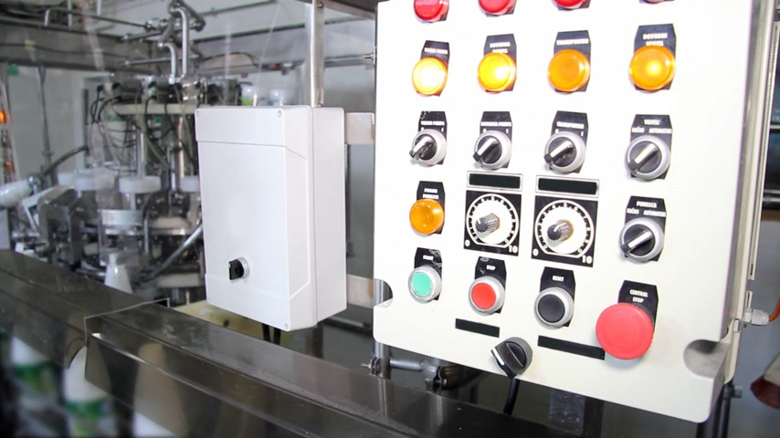 nabiał : Industrial equipment and control panel for bottling of yogurt in dairy factory