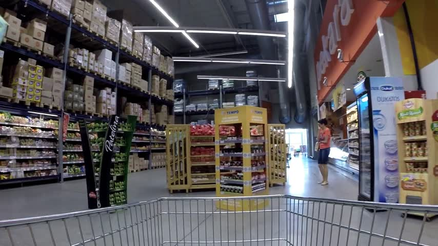 lojas : Fast shopping cart in supermarket, timelapse