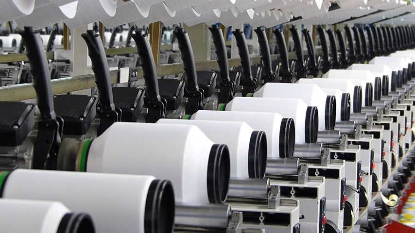 maquinaria : Textile manufacturing of synthetic fibers
