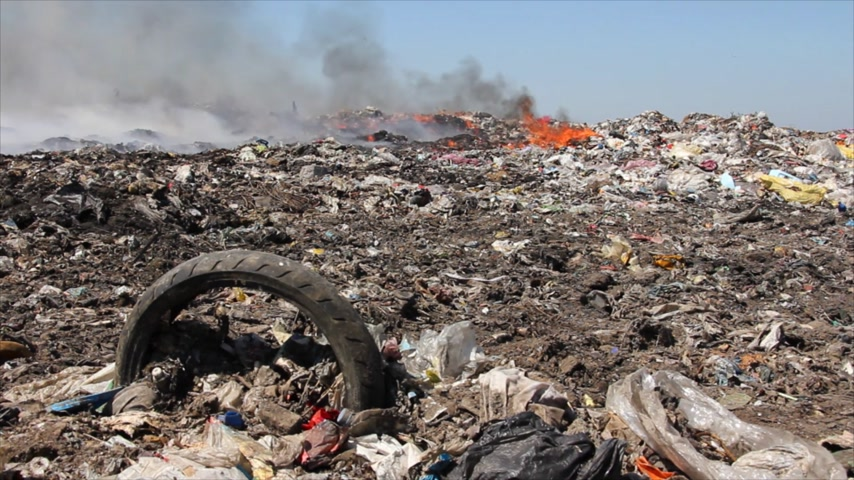 guba : Burning garbage dump, pollution