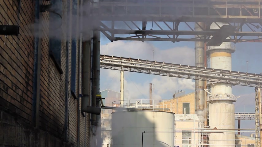 building heat : Industrial smoke and steam in sugar factory