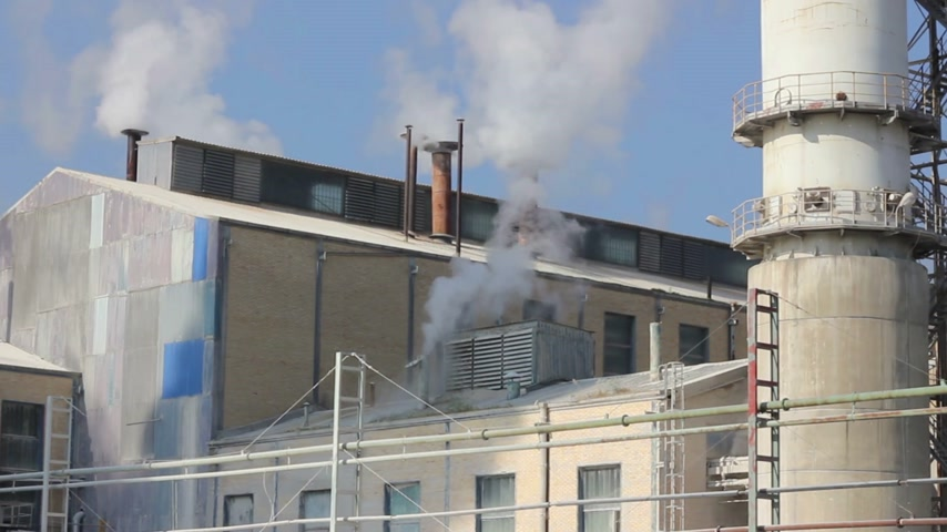 exterior : Industrial smoke and steam in sugar factory