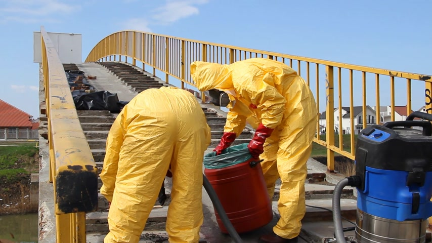 bio hazardous : Removing of dangerous materials, professional  people in protective uniform dealing with chemicals and dangerous materials