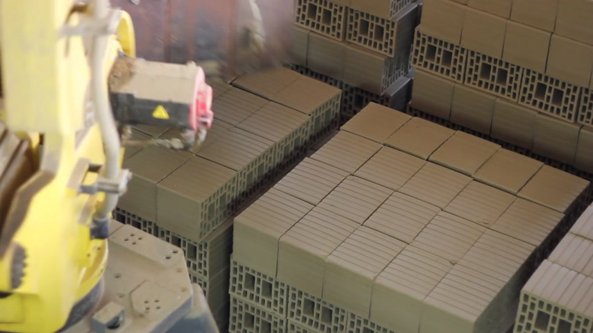 furl : Making bricks and blocks in a factory, robot in the work Stock Footage