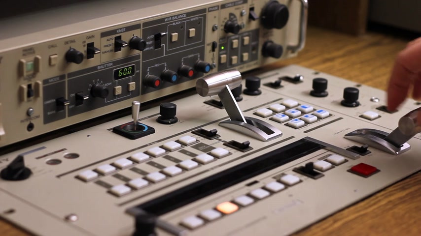 ntsc : Man working on a video mixer in the studio on television