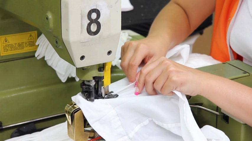 nejlon : Women sew on a machine in a textile factory Stock mozgókép