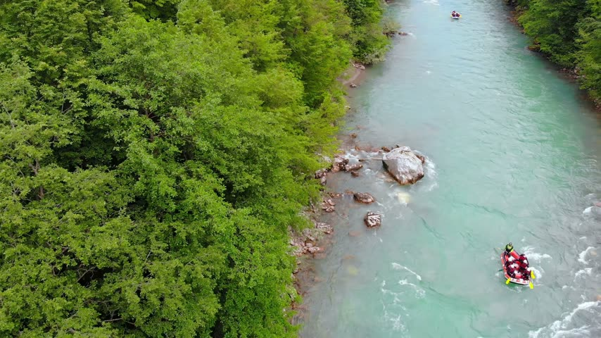 remo : Aerial shot of people in boats whitewater rafting trip on Tara river in Montenegro, two boats