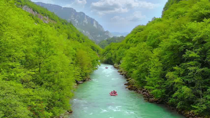 riskantní : Aerial shot of people in boats whitewater rafting trip on Tara river in Montenegro, three boats