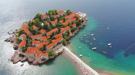 Aerial view of St Stephen Island. Flying over Adriatic sea, sunny day. Aerial drone shot, St Stephen Island in Montenegro