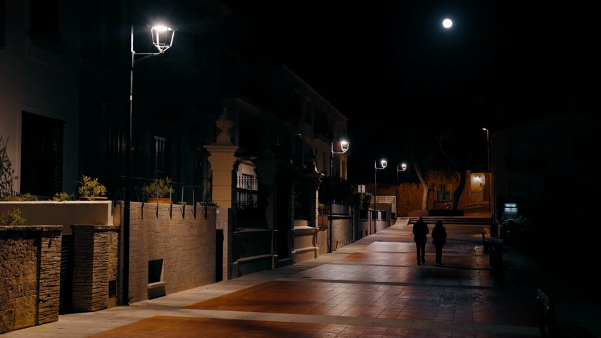 lanterns : A couple walks along the night street of a small coastal town. Yellow light of lanterns illuminates the street. Small houses with balconies and promenade. Inspiration. Night walk.