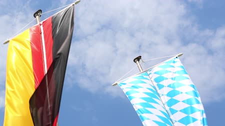 bavaria flag : Germany and Bavaria flags in front of blue sky Stock Footage