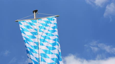 bavaria flag : Bavarian flag in front of blue sky Stock Footage