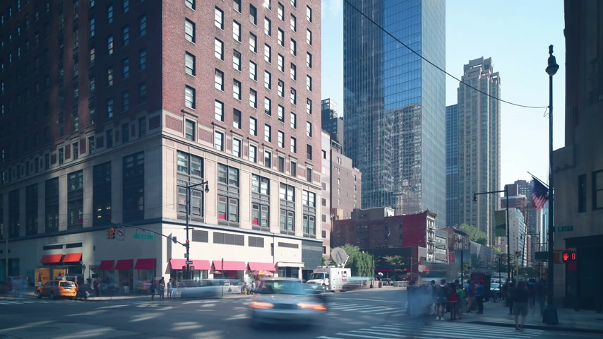 avenida : day light manhattan crossroad traffic 4k time lapse from new york Stock Footage
