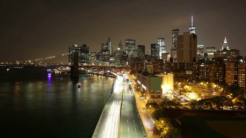 night scene : manhattan night light traffic river road 4k time lapse Stock Footage