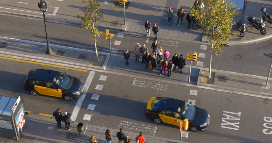 vista frontal : pedestrian road traffic street roof top view 4k barcelona spain Stock Footage