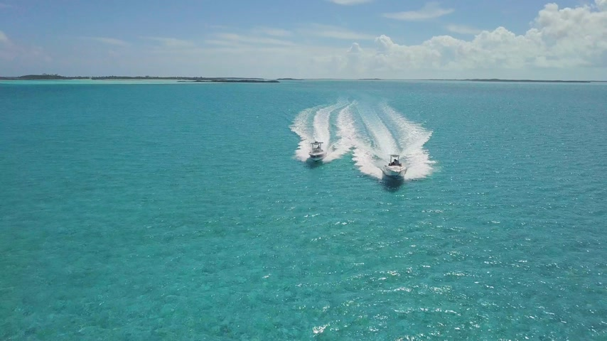 amazonka : drone bird view of 2 boats in the bahamas. summer vaction