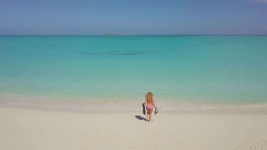 flippers : Female snorkeler in turquoise waters. exuma bahamas