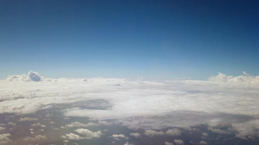 flying above clouds from airplane window Dostupné videozáznamy