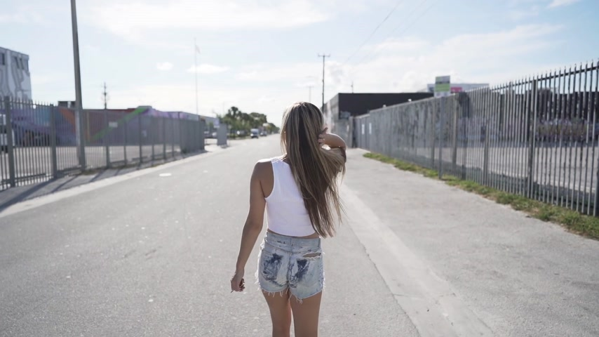 happy young woman walking and spining around. slowmotion