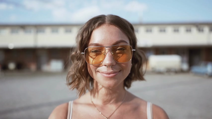 closeup of a young woman. smiling in slowmotion