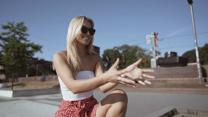 girl catching a retro camera and making pictures. slowmotion