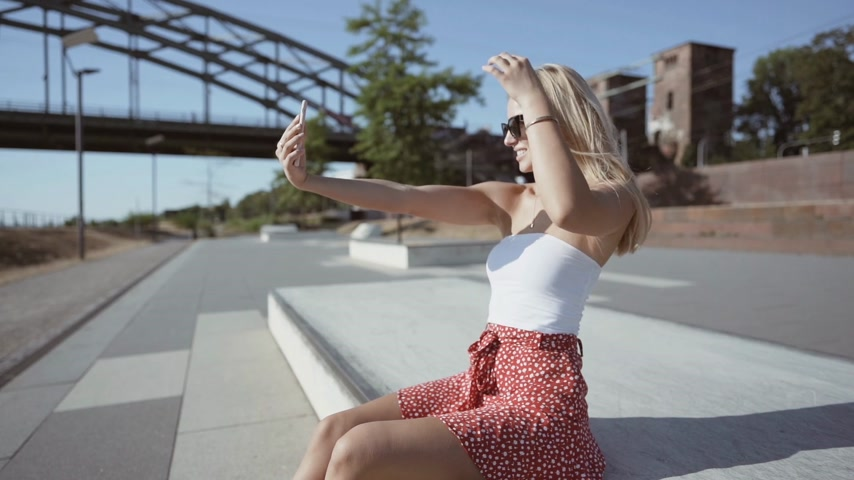 beautiful girl taking selfies in the city. slowmotion