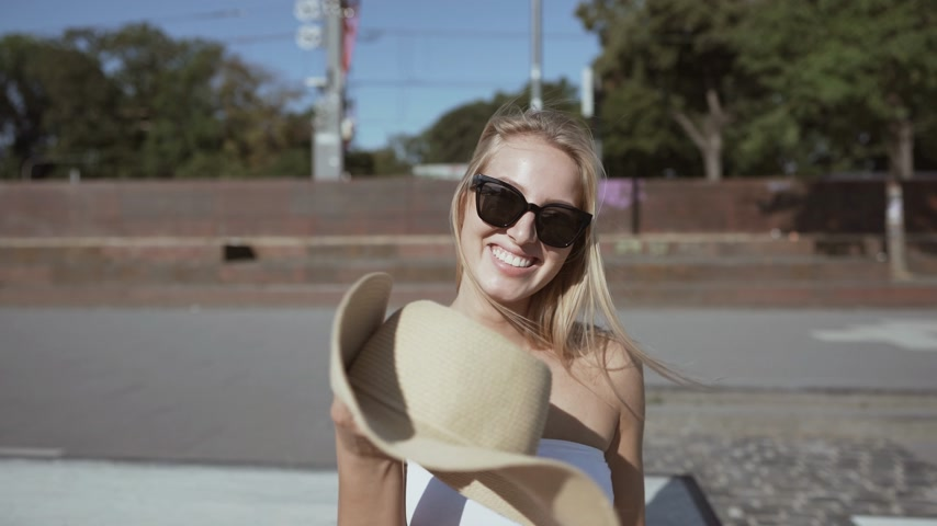 young woman with a hat and sunglasses. summerfeeling