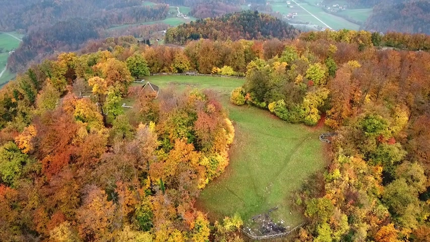 archeological : Aerial: Filming beautiful Slovenian country landscape at autumn early morning. Flying on cold autumn morning with beautiful sunrise.