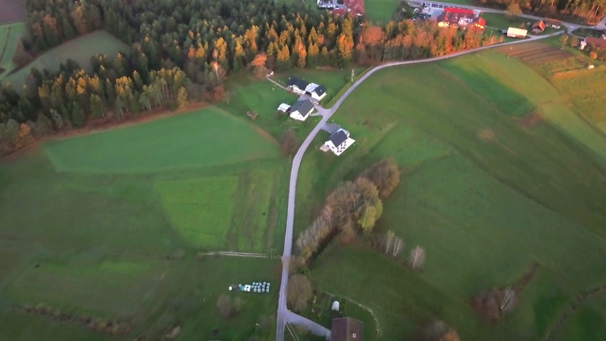 slovinsko : Aerial: Filming beautiful Slovenian country landscape at autumn early morning. Flying on cold autumn morning with beautiful sunrise.