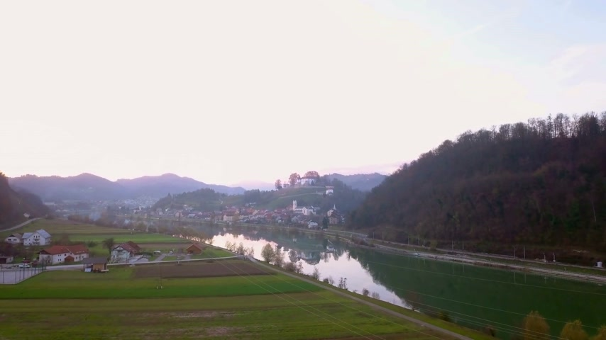 un : Aerial: Flying towards city Sevnica beside river Sava in Slovenia