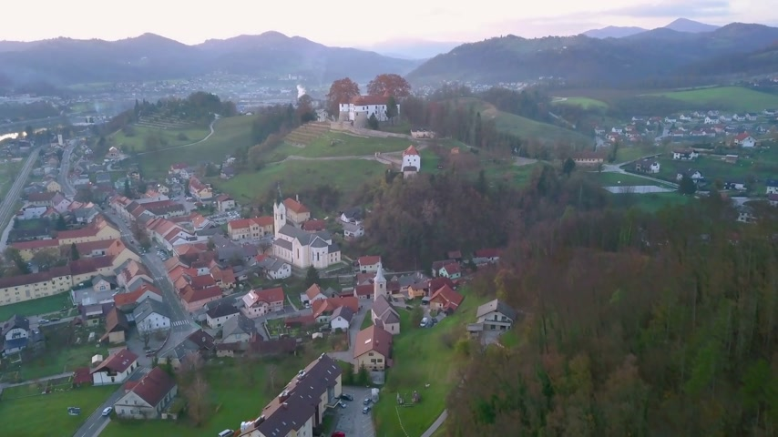 conhecido : Aerial: Flying towards city Sevnica beside river Sava in Slovenia. Beautiful small city with castle is the birth place of first lady Melania Trump.