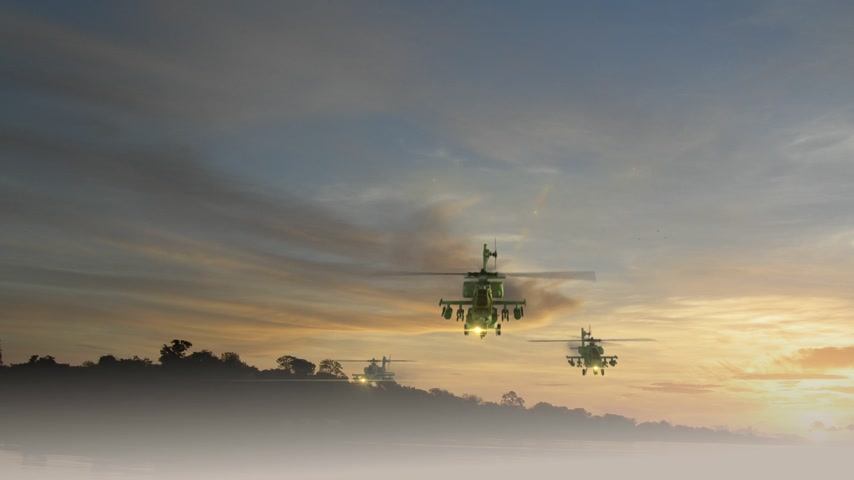 roket : Apache Helicopters coming toward camera against orange sunset Stok Video