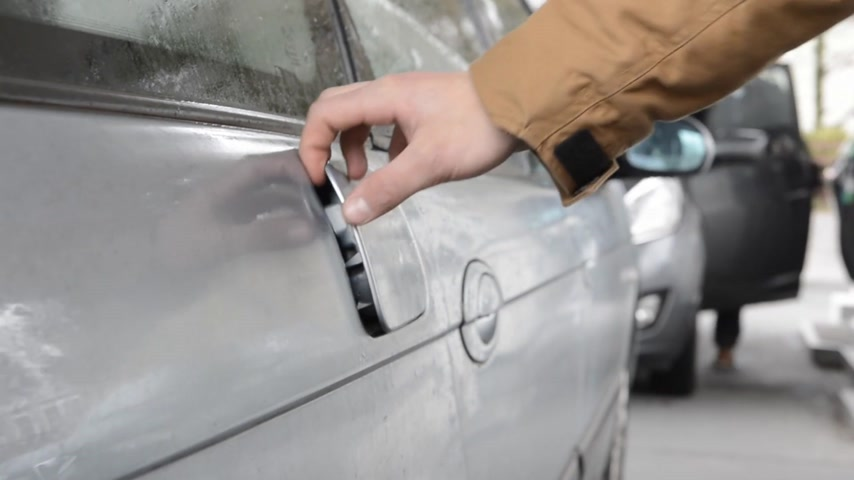 unscrewing : Hand, opening the fuel cap of a vehicle at a petrol station