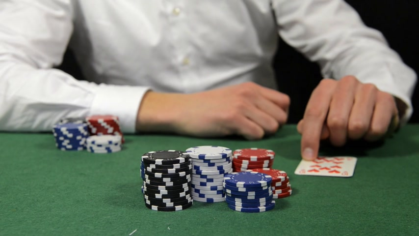 tens : Poker player winning the pot with a pair of tens, sitting back and folding his arms
