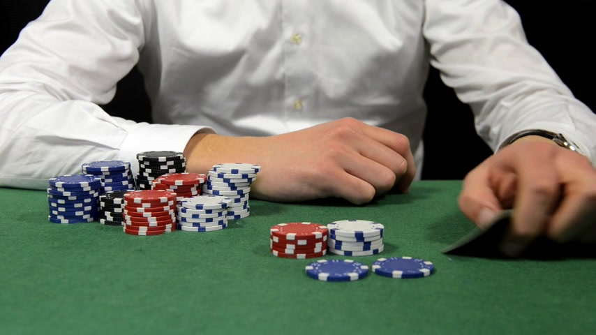 tens : Poker player with a stack of chips showing his hand with a pair of kings, sitting back and folding his arms