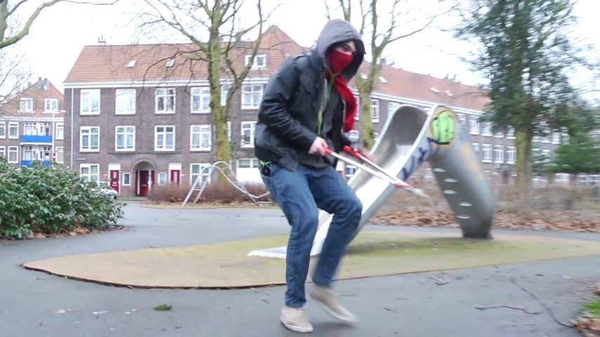 bicycle : Man stealing a bicycle: He  runs with a bolt cutter towards a parked bicycle, cuts through the padlock, removing the chain, and races a way.  Stock Footage
