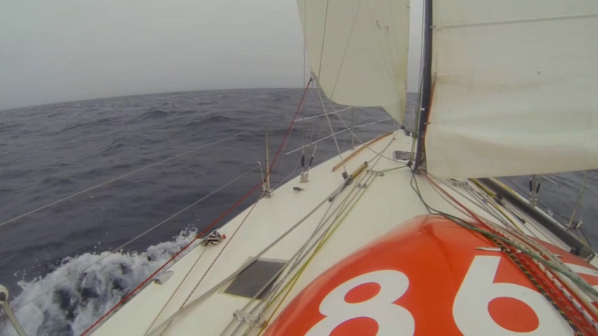 lanoví : Racing yacht with reefed mainsail and jib to windward during a trans Atlantic crossing