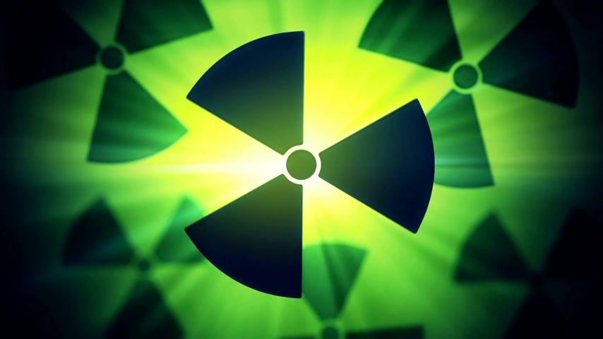znak : Radioactive danger symbol with a shine green background