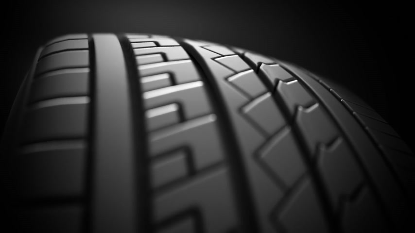 wyscigi : Close up on a car tire in motion.