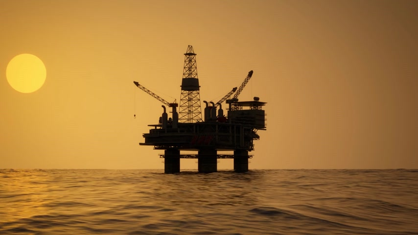 sunset sea : Silhouette Of An Oil Rig Drilling Platform At Sunset