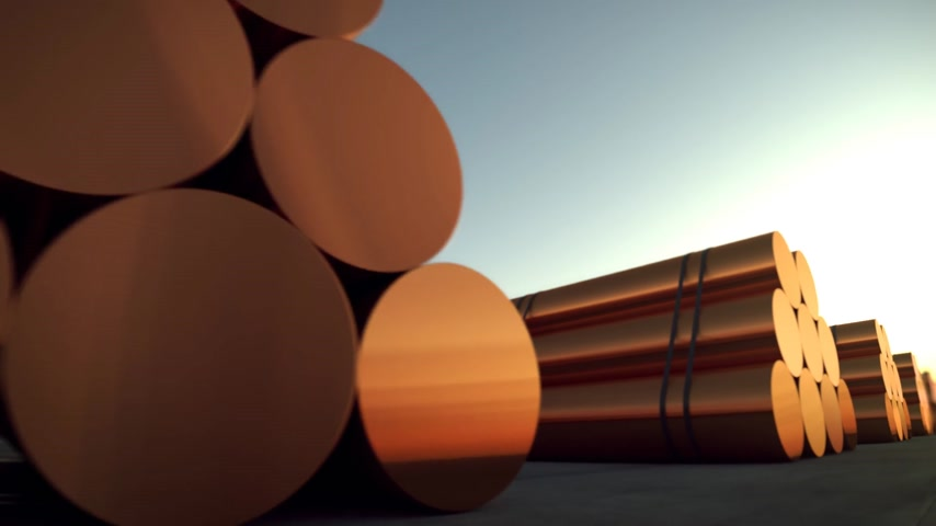 coppery : Loopable animation presents stacks of cylindrical copper billets. In background cloudless dawn sky. Stock Footage