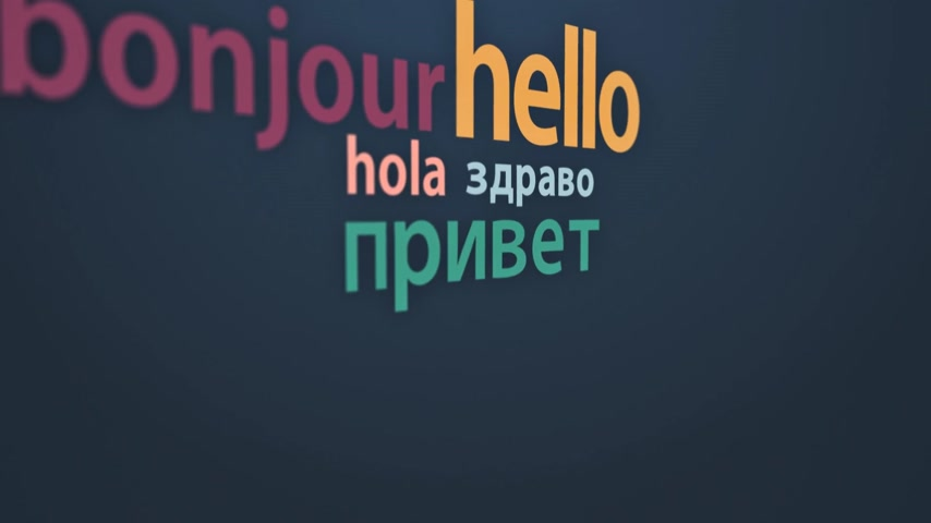 olá : Language learning concept with a class blackboard covered in colorful text depicting the word - Hello - in multiple different international languages with random orientation Stock Footage