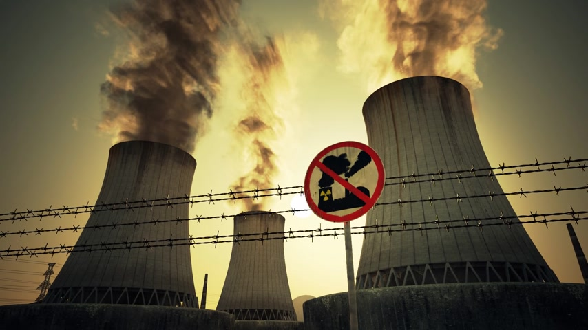 farpado : Nuclear power plant antinuclear sign and barbed mounted at the foot of three large tall cement chimneys exhausting smoke and fumes into the atmosphere, Sunset.