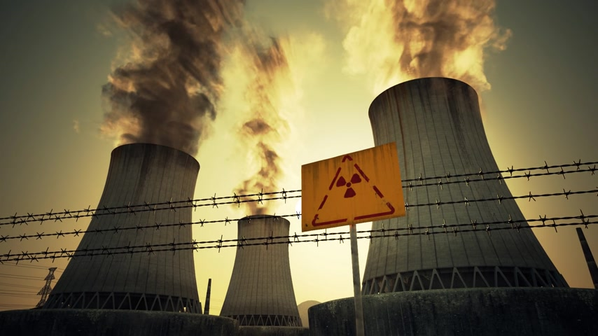farpado : Nuclear power plant radioactive sign and barbed wire mounted at the foot of three large tall cement chimneys exhausting smoke and fumes into the atmosphere, Sunset.