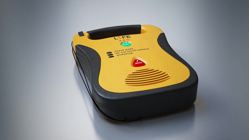 first aid kit : An Automatic Electronic Defibrillator On Grey Background