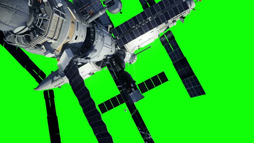 Space Station And Astronaut On Green Screen
