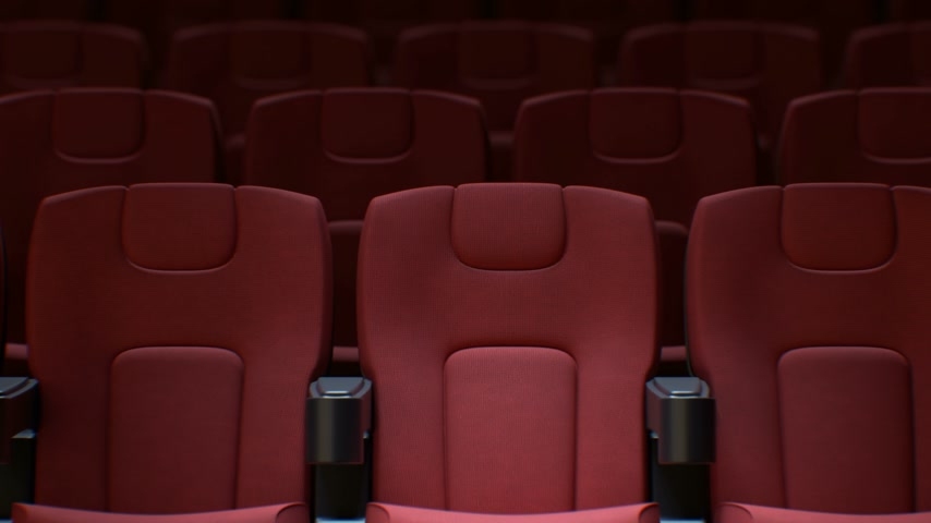 Seamless Red Chairs in Cinema Hall. Looped 3d Animation of Rows of Red Seats in Cinema with DOF Blur. Art and Media Concept. 4k Ultra HD 3840x2160.