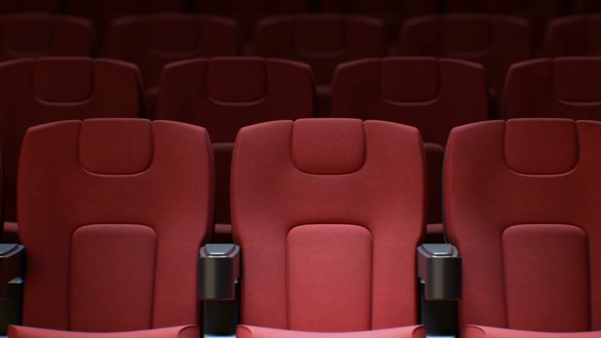 Flashing Light from the Cinema Screen on the Red Chairs in Cinema Hall Seamless. Looped 3d Animation of Rows of Red Seats in Cinema. Art and Media Concept. 4k Ultra HD 3840x2160.