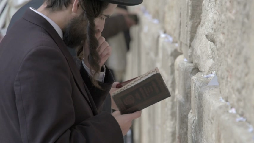 wailing : Orthodox jews praying in the Western Wall. Jerusalem. Israel. Tilt up and down